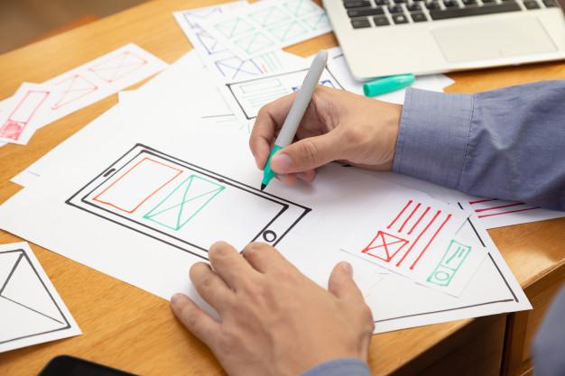 Desenho de um prototipo de um app em papel